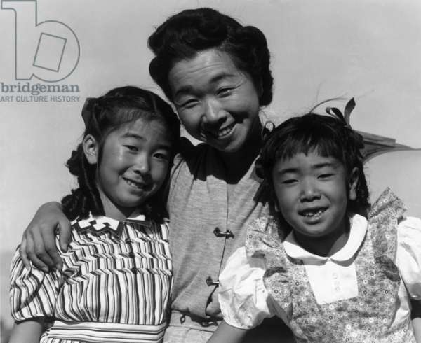 Mrs. Nakamura and her two daughters, Joyce Yuki and Louise Tami, Manzanar Relocation Center, California, 1943 (photo)