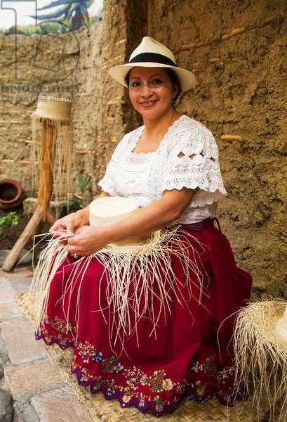 Woman weaving a panama hat from toquilla straw at the Homero Ortega Panama Hat Factory (photo)
