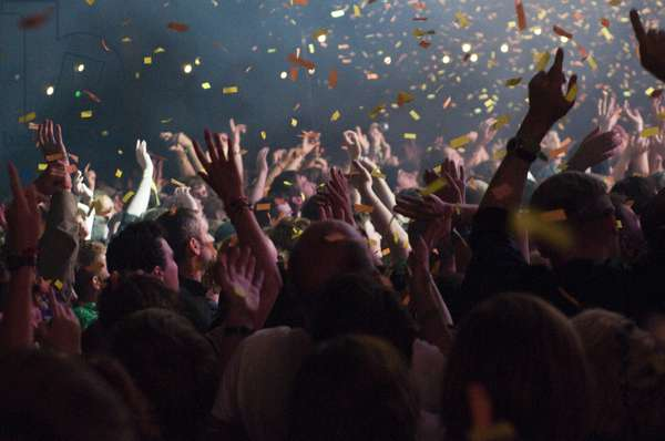 Crowd being showered with confetti, at a music festival, UK