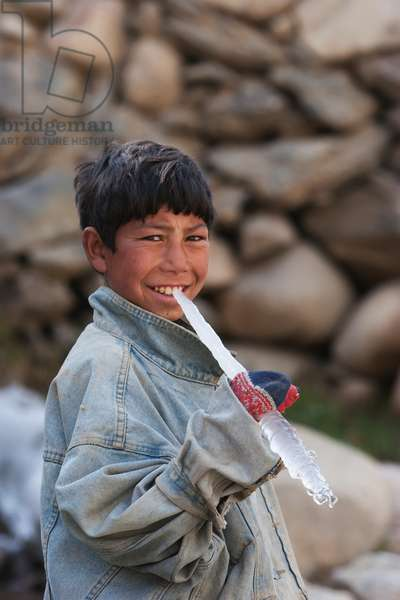 Boy Holding An Icicle in Aab-E-Noraq, Bamian Province, Afghanistan (photo)