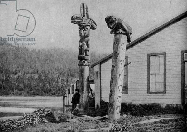 North America. Alaska. Indian totems at an Alaskan village. 1920