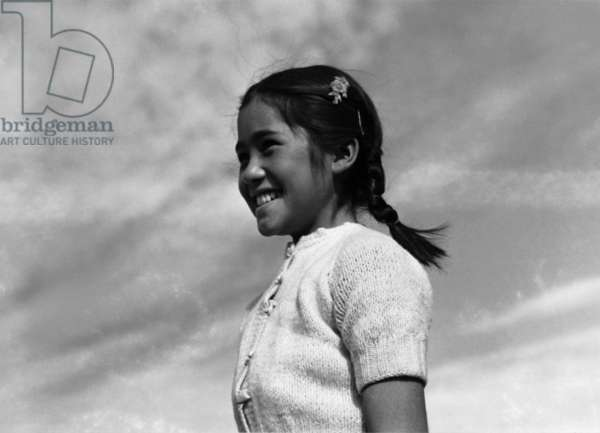 Girl smiling, Manzanar Relocation Center, California, 1943 (photo)