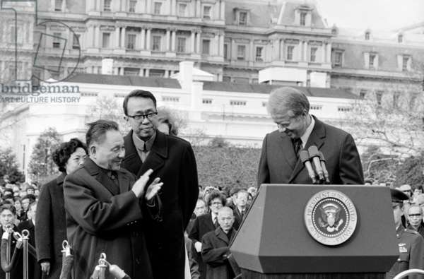 The Chinese Vice Premier Deng Xiao Ping applauding President of the United States Jimmy Carter, 1979