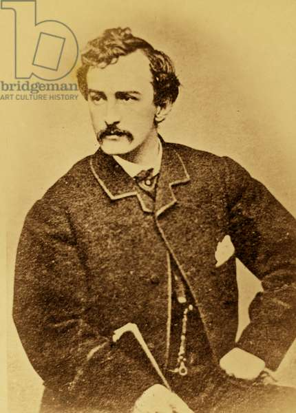 John Wilkes Booth, half-length portrait, facing left and holding a cane 1860 (photo)