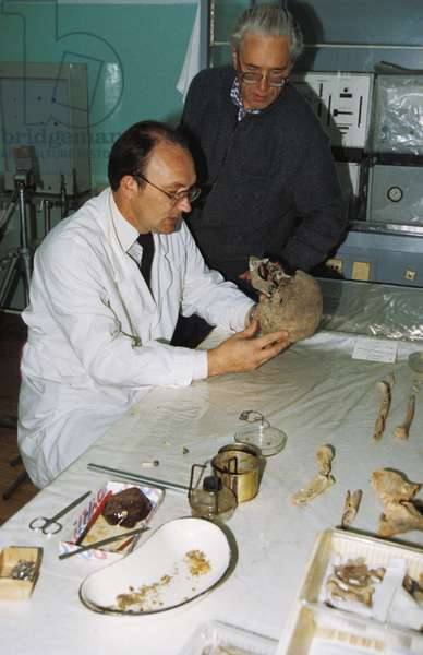 Forensic Experts N, Nevolin and A, Avdonin Examine the Remains of the Romanov Family in Yekaterinburg, Russia, 1992.