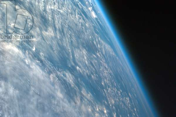 Image shot over northwestern part of the African continent captures the curvature of the Earth and shows its atmosphere. taken from the Space Shuttle on September 04, 1997.