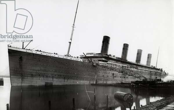 RMS Titanic During Fitting Out, 01/01/1912. White Liner, built by Harland & Wolff in Belfast, nearing completion. Titanic left Southampton and Cherbourg on her maiden voyage to New York on April 10th 1912. The steamship sank April 15th 1912 off the coast of New Foundland after striking an iceberg with the loss of 1,635 passengers and crew. (Photo by Titanic Images/Universal Images Group) Photographie ©UIG/Leemage