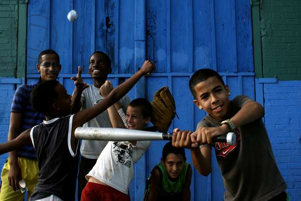 A group of playful children. Havana City, 50th Anniversary of the Socialist Revolution. In 2009, while the Cuban society remains in constant adaptation and after the Regime entered into a new social and economic post-Sovietic period, Cuba reflects the need of present day revolutionary changes. Havana, Cuba. January 2, 2009.  (photo)