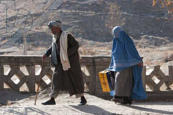 Old Man and Woman Wearing A Burqa on A Kabul Street, Afghanistan (photo)
