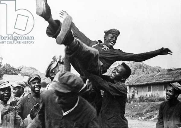 Korean War. African American prisoners in a North Korean POW camp celebrating upon hearing news of the armistice. August 1953.