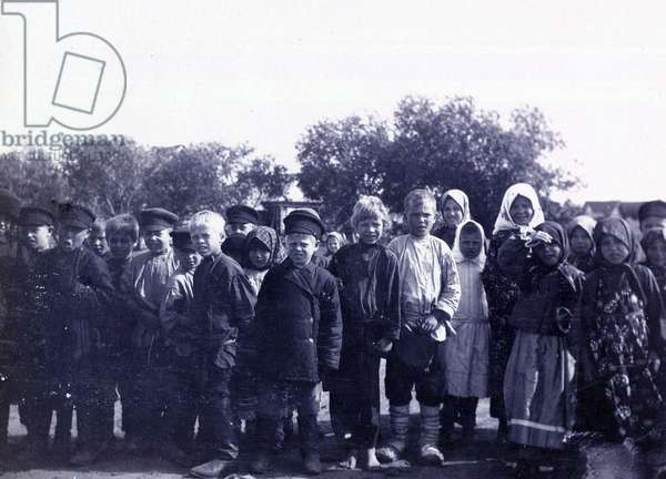 Russian peasant children photographed in the year of the tercentenary of the Romanov Dynasty