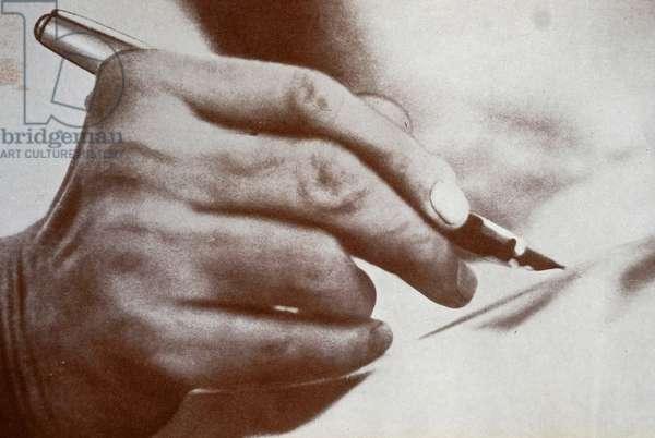 A pen held in the hand of Mohandas Karamchand Gandhi