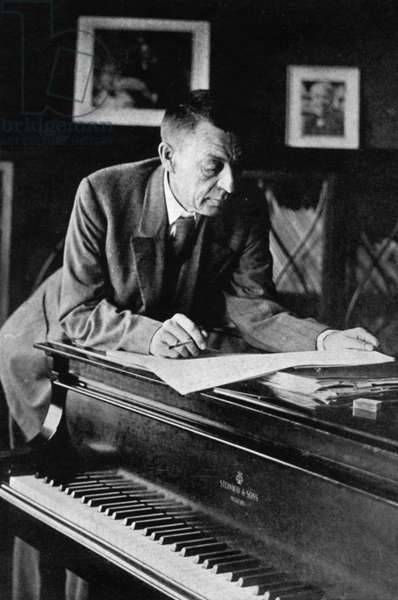 Russian Composer, Sergei V, Rachmaninov, Looking over a Manuscript at his Piano in the Late 1920s.