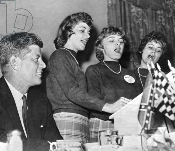 JFK Listens To Campaign Song (b/w photo)