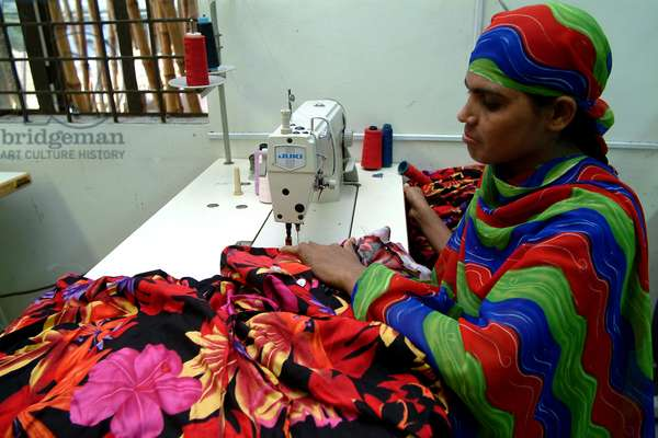 An RMG (Readymade Garments) worker inside a factory. Garments sector contributes the highest to the GDP of Bangladesh. Bangladesh. November 15, 2002.  (photo)