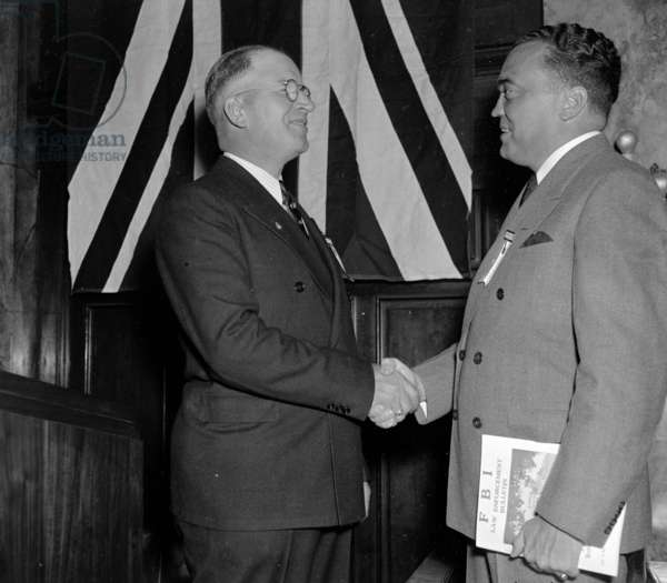 J. Edgar Hoover, (right) Director of The Federal Bureau of Investigation, is greeted by Arthur Muchow, President of the International Association for Identification,