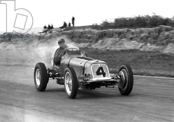 Bob Gerard driving a smoking ERA (b/w photo)