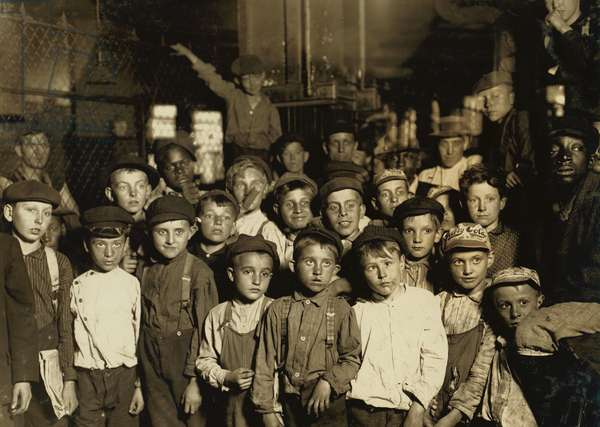 Indianapolis Newsboys waiting for the Base Ball edition, in a Newspaper office. 1908 (photo)