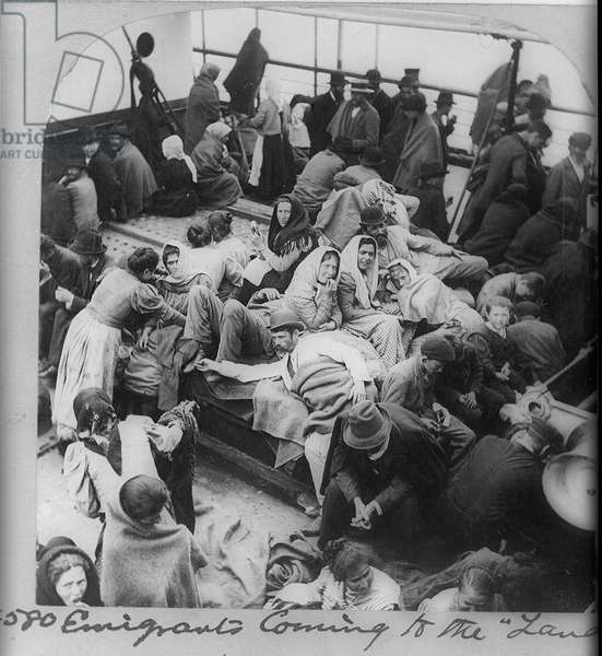 Immigrants, probably Russian or Polish, on board a boat approaching New York, USA. Photograph c1900.