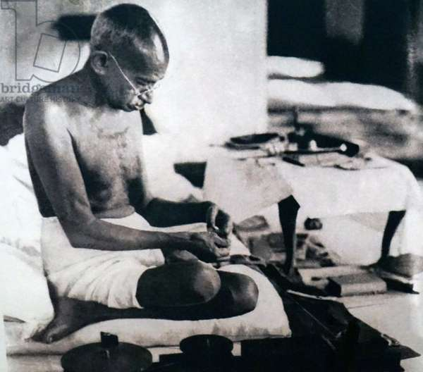 Mahatma Gandhi spinning homespun cloth during a protest against British Rule, India