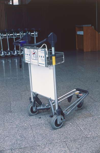 Airport luggage trolley.