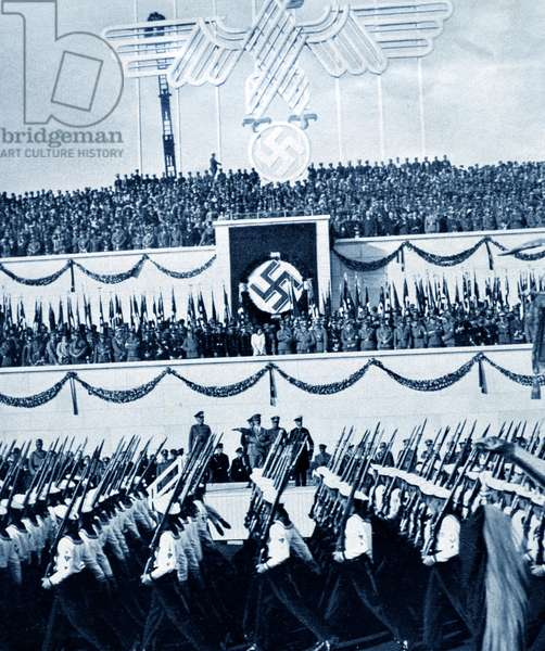 Senior naval and army  commander with Adolf Hitler review marines at a rally at Nuremberg 1935