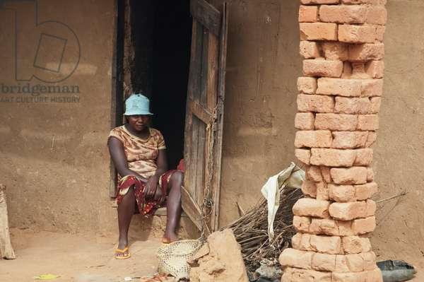 Man Sitting in Front of His Home in Ambalavao, Fianarantsoa Province, Madagascar (photo)