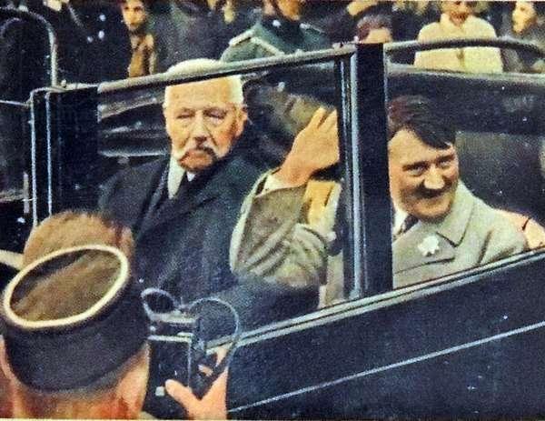Von Hindenburg and Hitler riding in car