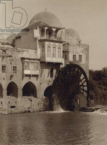 Water Wheel Ouside of Mosque turns by its passing River 1920 (photo)
