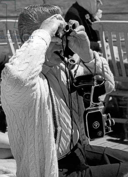 A Tourist With His Gear (b/w photo)