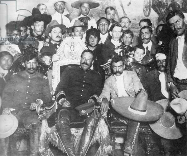 Rodolfo Fierro (far right), stands by as Pancho Villa (in the Presidential chair) chats with Emiliano Zapata at Mexico City. Tomas Urbina is seated at far left, Otilio Montano (with his head bandaged) is seated to the far right.