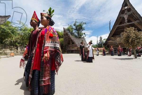 Toba Batak people performing a traditional Batak dance at Huta Bolon Museum in Simanindo village on Samosir Island, Lake Toba, North Sumatra, Indonesia (photo)
