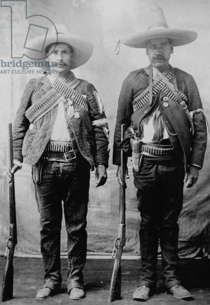 Pancho Villa's Men Urbino & Iluarte stand at attention with rifles, bandoliers and Pistols 1917 (photo)
