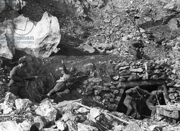 Korean War. American soldiers hidden in a cave are captured by Chinese People's volunteers.
