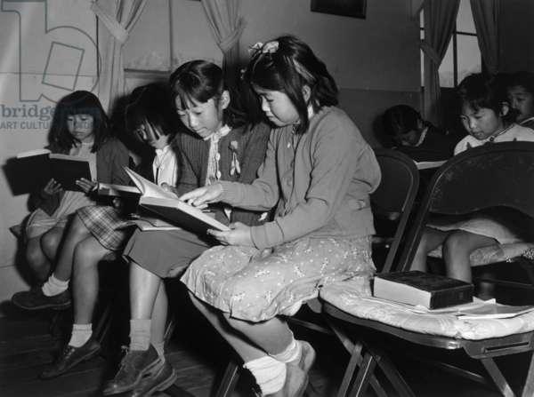 Children at Sunday school class, Manzanar Relocation Center, California, 1943 (photo)