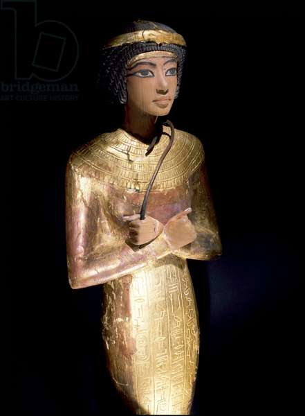 One of the many shabti from the tomb of Tutankhamun, Holding crook, 18th dynasty, c.1357 - 1349 BC (gilded and stuccoed wood)