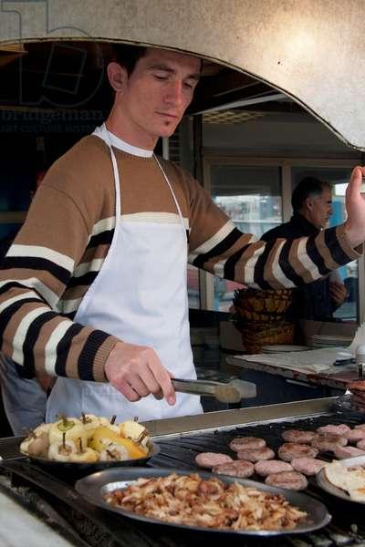 Man Cooking Food, Prishtina, Kosovo (photo)