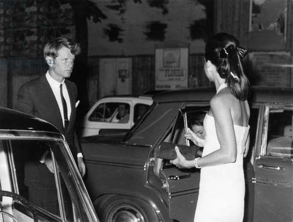 Senator Robert Kennedy with his wife. Via Veneto. Rome. 1966.