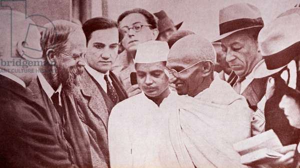 Gandhi with reporters, taken at Marseilles.