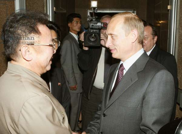 President Vladimir Putin (R) Bids Farewell to North Korean Leader Kim Jong-Il in Vladivostok on Friday, the Korean Leader has Ended his Visit to the City Today, 23, 08, 2002.