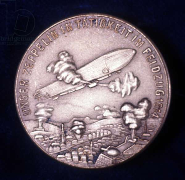 Zeppelin airship in action during World War I. Reverse of medal commemorating Count Ferdinand von Zeppelin (1838-1917), German army officer.