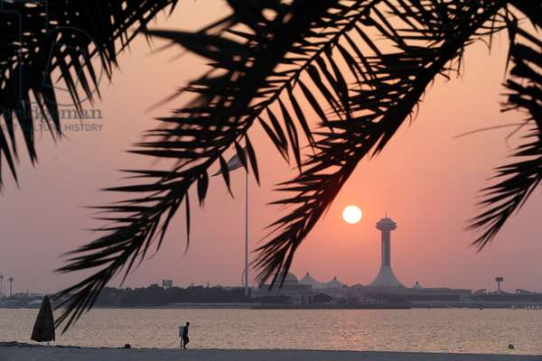 Abu Dhabi waterfront and Breakwater Tower at sunset, United Arab Emirates, 2015 (photo)