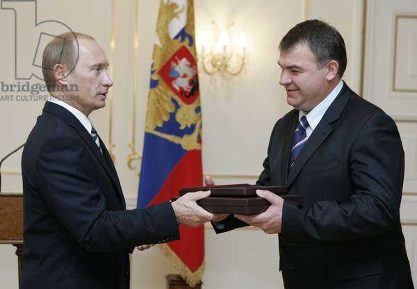 President of Russia Vladimir Putin (L) Hands over the Awards, Posthumously Conferred on the Soviet Spy George Koval, to Defence Minister Anatoly Serdyukov to Be Stored at the Museum of Russia'S Main Intelligence Directorate, or Gru, During a Ceremony in Novo-Ogaryovo Residence, Moscow, Russia, November 2, 2007.
