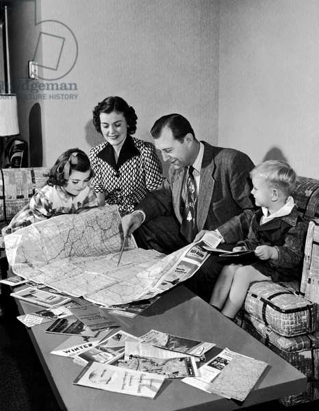 Family Plans A Vacation (b/w photo)