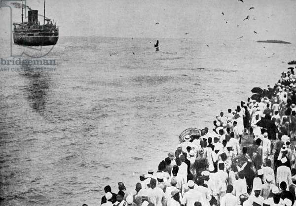 Crowds wave farewell to Mahatma Gandhi and his ship the SS Rajputna as he sails to join the Second Round Table Conference on India.