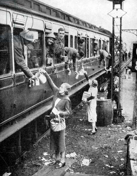 Local residents supplying refreshments to trainload of British soldiers who had been withdrawn from the beaches of Dunkirk on 3-4 June 1940 and brought back to England.