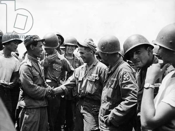 Korean War. American soldiers fraternizing with soldiers from the Korean People's Army at a joint celebration after the signing of the armistice. August 10, 1953.