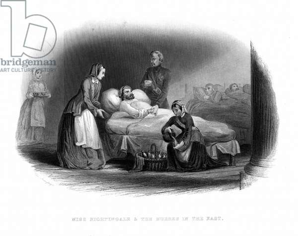 Florence Nightingale (1820 -1910) English nurse, in the hospital at Scutari with the doctor who is taking the patient's pulse. Crimean War 1853-1856. Engraving.