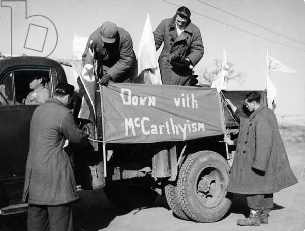 Korean War. American and British POW's of the Songgongni camp, who refused repatriation, decorating the truck that will take them to Kaesong. February 1954.