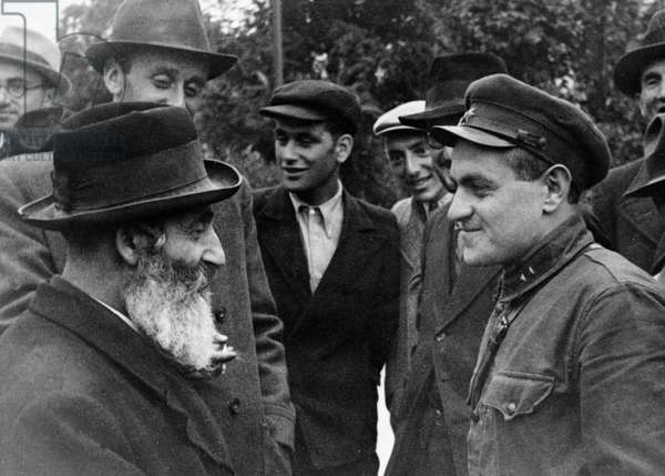 Soviet Lieutenant I, Falkovich Speaking with a Jewish Resident of Ternopil, Western Ukraine, October 1939, the Soviet Army Entered the Village a Month Earlier.